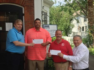 Pictured above is firm partners Kevin Wystup (left), and Dave Mackowiak (right) presenting Fredonia Little League President, Chad Bongiovanni and Dunkirk Little League President, Gary Haase checks for $500.00 each to help support the youth baseball organizations.