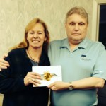 Mrs. Puckhaber, iPad mini winner, and Firm Partner, Kevin Wystup.